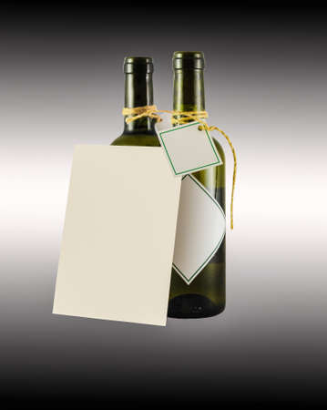 white wine: two bottles of wine with greeting card on the black background