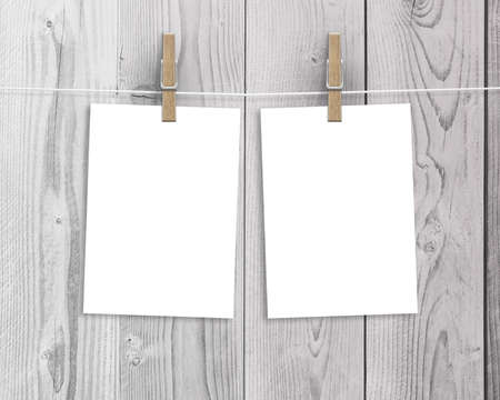 paper sheet: Paper cards hanging on a clothesline with clothespins on wood background