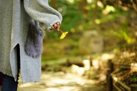 Women with a leaf of Ginkgo biloba 写真素材