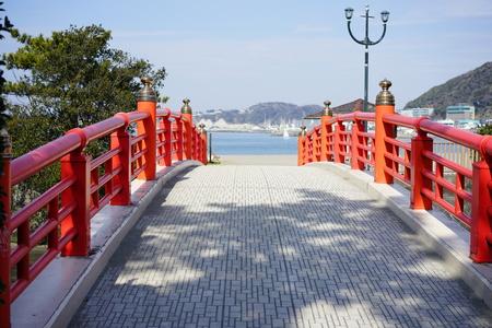 A red bridge towards the sea
