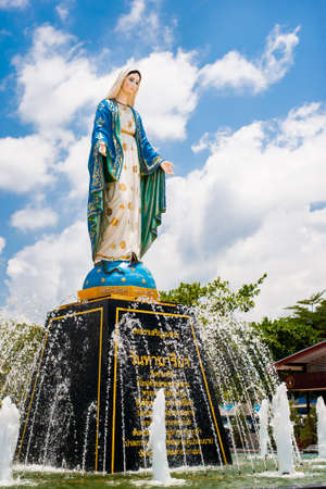 mother mary: Blessed Virgin Mary at the sky background  Mother Mary statue Stock Photo