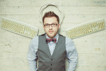 male angel: Young computer man like an angel with keyboards instead wings Stock Photo