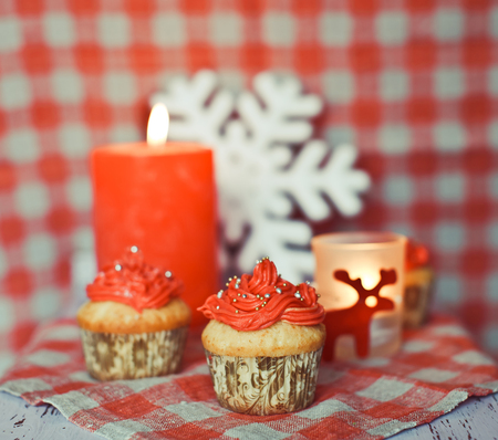 wintery: Red wintery cupcakes to celebrate New Year and Christmas Stock Photo