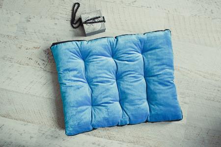 matress: Blue pet matress on the wooden floor