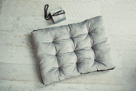 matress: Grey pet matress on the wooden floor