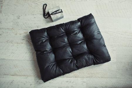 matress: Black pet matress on the wooden floor