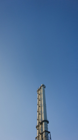 Vertical factory chimney photo