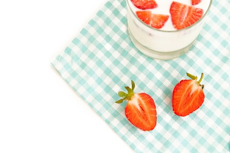 harvest background: Summer harvest background: sweet strawberry and fresh milk on a tablecloth isolated on white