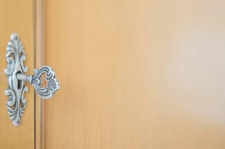 Close-up photo of an obsolete key inside a keyhole