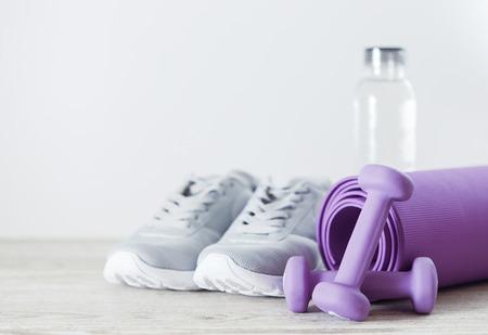 Dumbbells, measure tape and fitness equipment