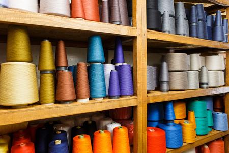 Colored skeins on the shelfs Stok Fotoğraf