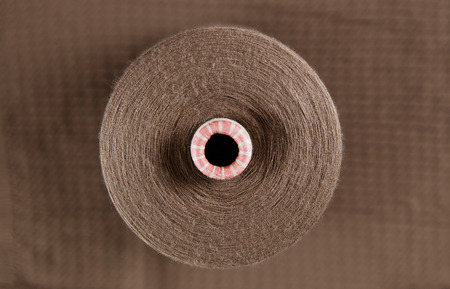 Brown colour skein on the textile background