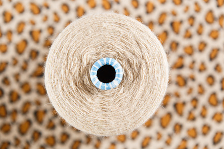 Nude colour skein on the textile leopard background Stock Photo
