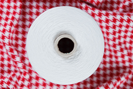 White colour skein on the red and white textile background Stock Photo