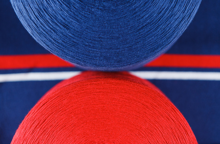 Red and dark blue colour skeins on the textile dark blue background Stock Photo