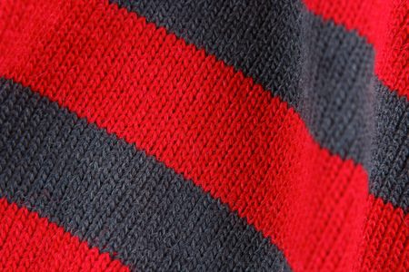 Closeup red and grey color knitted cotton textile