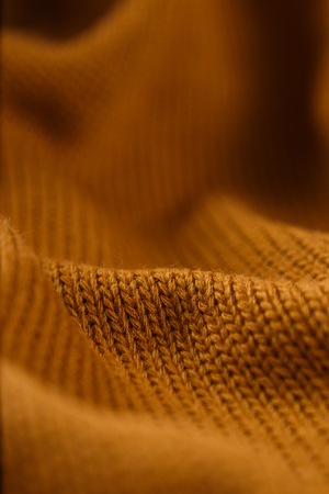 Orange color cotton knitted textile as background