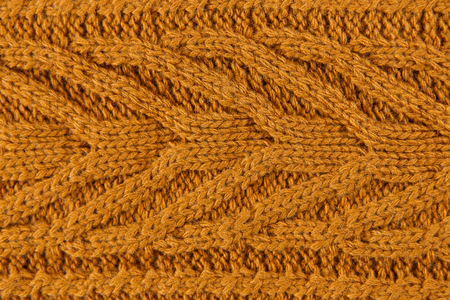 Orange color cotton knitted textile with pattern as background