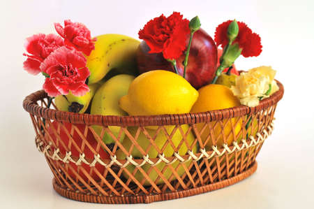 A basket with fruit and flower Stock Photo - 4681687