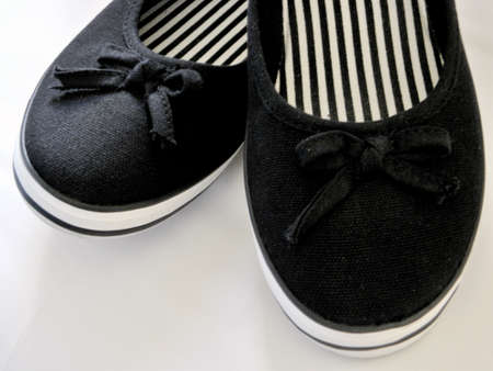 plimsoll: White and black shoes - plimsoll.