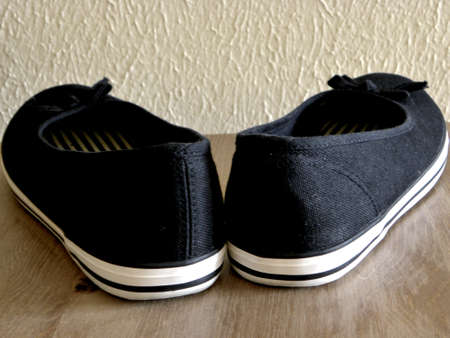 plimsoll: Black and white plimsoll with bows.