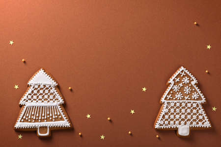 Christmas gingerbread trees composition with golden stars and balls on brown paper background Stock Photo - 16790372