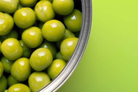 canned peas: Canned peas on green background. Macro shot with copy space