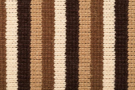 cotton wool: Knitted fabric texture for background. Brown stripes, closeup