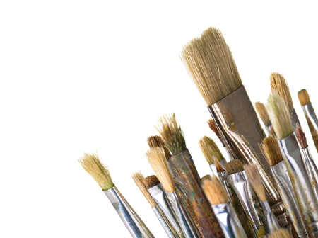 Paint brushes isolated on white background, macro shot with empty room for text photo
