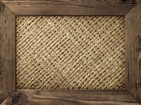 marco madera: Antiguo marco de madera con material de arpillera dentro