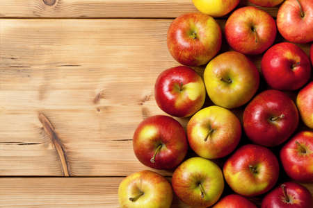 Apples on wooden table, top view nature background with copy space photo