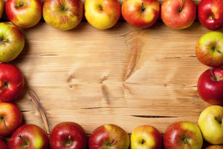 kitchen table top: Apples on wooden table. Fresh fruit background with copy space