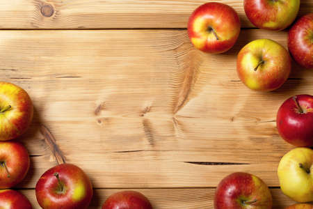 room for text: Apples on wooden table background. Fresh fruit backdrop with empty room for text Stock Photo