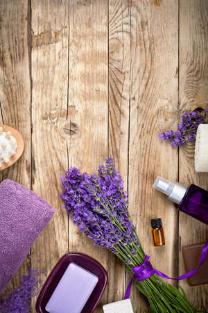 Lavender spa beauty treatment products on wooden table. Empty room for text. Top view