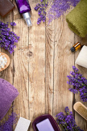 foot spa: Lavender wellness products on wooden table. Copy space. Top view