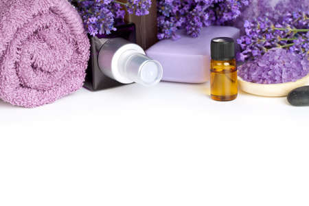 aromatherapy oils: Lavender spa with flowers, oil, salt - beauty composition on white background with copy space
