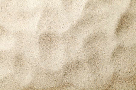Sandy background. Summer beach texture. Top view. Copy space photo