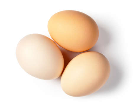 boiled: Three eggs on white background. Top view Stock Photo