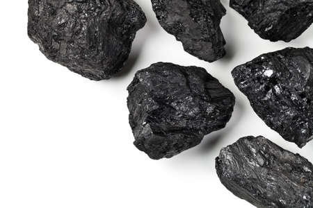 Coal on white background with copy space. Top view