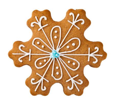 galleta de jengibre: Gingerbread copo de nieve aisladas sobre fondo blanco. Galleta de la Navidad