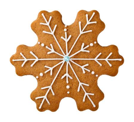 galleta de jengibre: Galleta de jengibre en forma de copo de nieve aisladas sobre fondo blanco