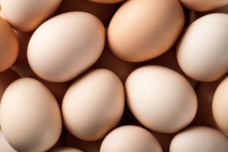 Eggs. Fresh brown chicken eggs. Top view