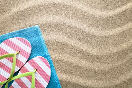 Beach background with towel and flip flops. Summer concept. Top view