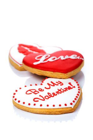 kiss biscuits: Cookies in shape of heart on white background for Valentines Day Stock Photo