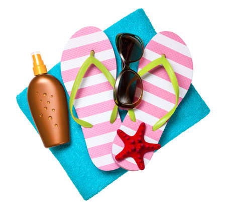 beach towel: Beach accessories. Flip-flops, towel, sun tan lotion and sunglasses isolated on white background. Top view