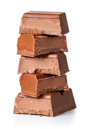 Stack of chocolate pieces on white background