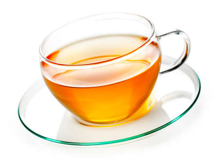 Tea in glass cup on white background