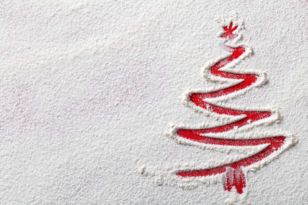 Christmas tree on flour background. White flour looks like snow. Top view Stockfoto