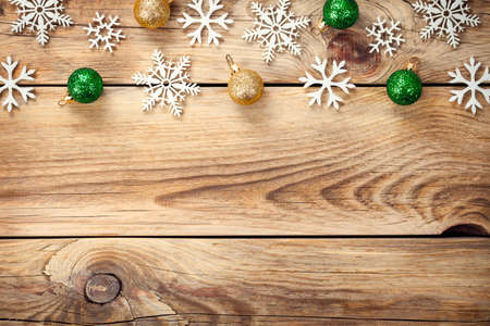 Christmas background with snowflakes and christmas balls on wooden table photo