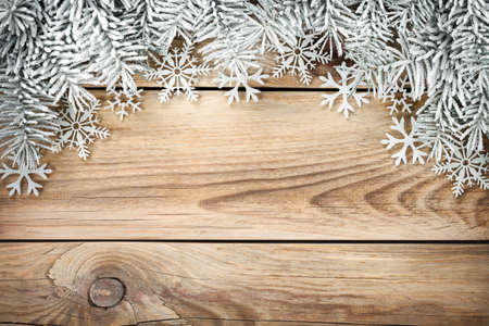 Christmas background with spruce tree covered with snow. Copy space. Top view photo